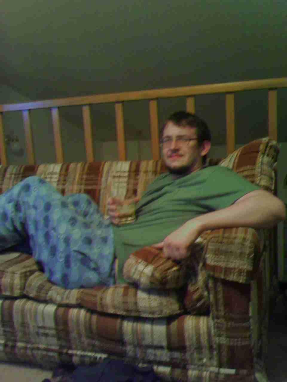 Chris Brodt in pajamas drinking whiskey
