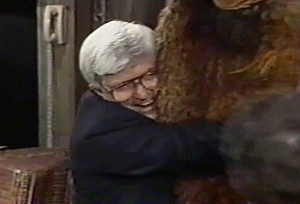 Picture from episode 2096 where Phil Donahue hugs Snuffleupagus